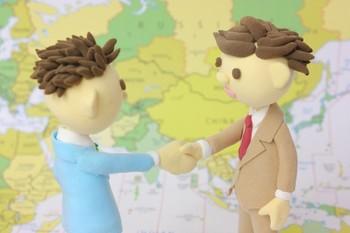 握手と地図.jpg
